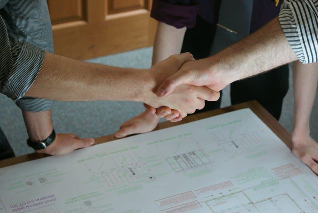 Handshake over plans
